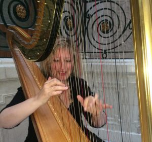 Fiona Thompson playing the harp