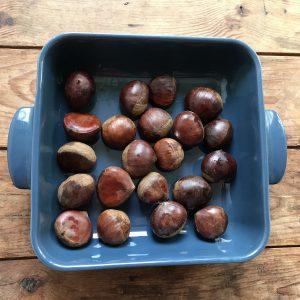 chestnuts in a blue ceramic dish
