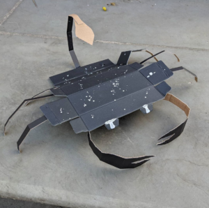 A scorpion made out of a cardboard box