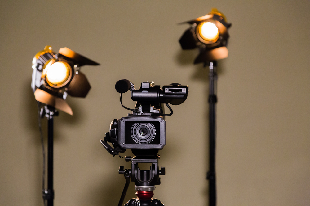 A video camera and two lights